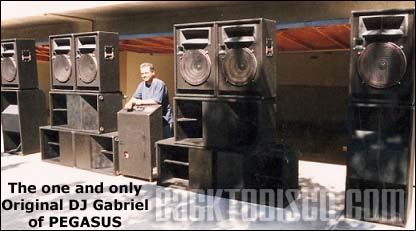Another photo of Gabriel in front of the Pegasus speakers.
