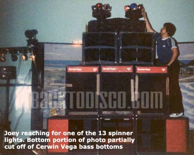 Joey of Pegasus reaching for one of the spinners on top of speakers stack. Pegasus was the dominant mobile dj system and lights in the late 70s and early 80s. Pegasus set the standards and bar for the future of mobile dj'n the the Southern California area.